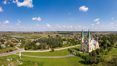Summer landscape, countryside. Aerial drone view of old church and traditional Ukrainian village