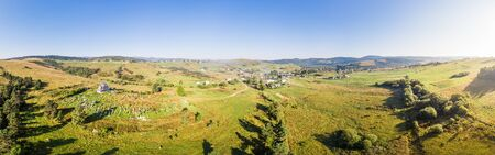Panoramic landscape of rural area. Aerial drone view of Matkiv village in Carpathians, Ukraine