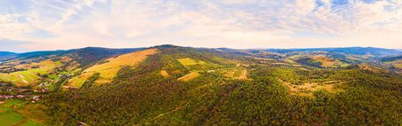 180 degrees panoramic landscape of countryside, aerial drone view of nature in Carpathians. Sunset time, end of summer.
