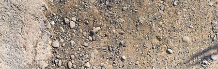 Destroyed asphalt cover on road. Bad road condition that needs repair. Banner size, top view. Theme of road construction and repair Stockfoto