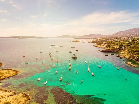 Incredible landscape. Yachts in the cove of turquoise sea, aerial drone view. Xinxell, Playa de Illetas, Palma de Mallorca, Balearic Islands. Popular tourist destinations.