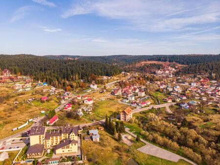Aerial drone view of Skhidnytsia popular healing spa resort in Carpathians, Ukraine. Balneological resort with mineral springs. Autumn scenic landscape