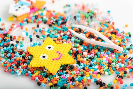 Toy in star form. Just made of fusible beads. Set, close up view. Stock Photo