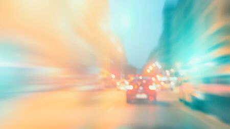 Abstract colorful blurry background, motion effect. Cars on the road, urban scene. Theme of city life, speeding and freedom. Imagens