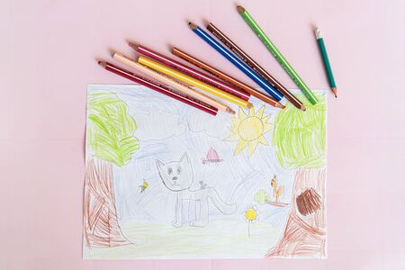Drohobych, Ukraine - April 16, 2020: Color picture drawn by child, top view. Lives of animals and insects. Gray cat with little kitten on the back on green lawn among trees. Idea is vision of world.