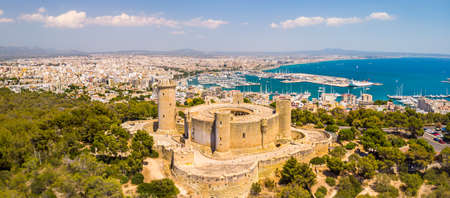 Aerial drone view of Palma de Mallorca city. Cityscape with view on Bellver castle, sea, marina, architecture. Majorca, Balearic Islands, Spain