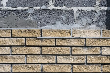 Wall cladding with decorative bricks, front view. Material for decorating the wall of house or fence.