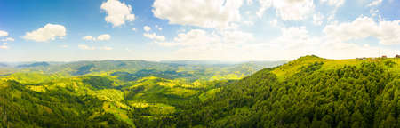180 degrees scenic panoramic landscape of nature in Carpathians, Ukraine. Beautiful mountains and forests on slopes