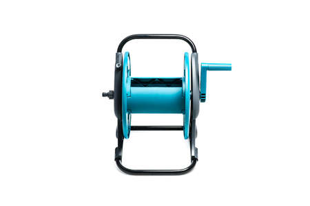 Plastic hose reel isolated on white background. Gardening tool for water supply and watering a garden or vegetable garden.
