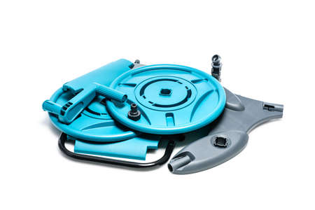 Details of disassembled plastic hose reel isolated on white background. Gardening tool for water supply and watering a garden or vegetable garden. 版權商用圖片