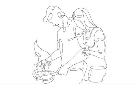 A loving couple prepares food in the kitchen. Homemade food.One continuous drawing line logo single hand drawn art doodle isolated minimal illustration. Reklamní fotografie