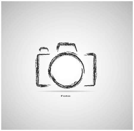 Kamera auf einem grauen Hintergrund mit einem Pinsel gezeichnet