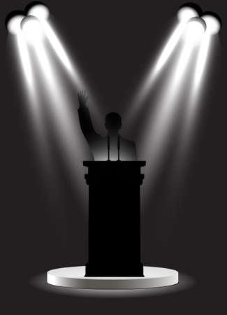 man on the podium under floodlights