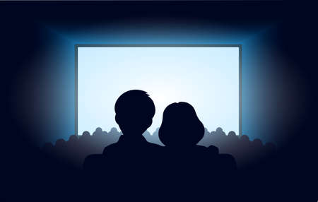 theater audience: silhouettes a loving couple at movie theater