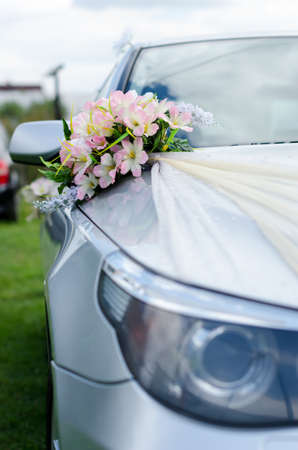 cars are decorated with wedding bouquets of beautiful flowers photo