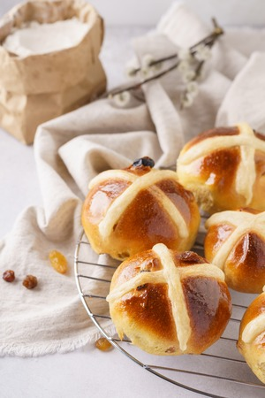 Homemade hot cross buns for breakfast. Sweet treats for Easter celebration.