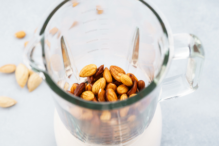 Blender with soaked almonds for making nut milk. Dairy free, no lactose vegan milk. Step by step recipe.