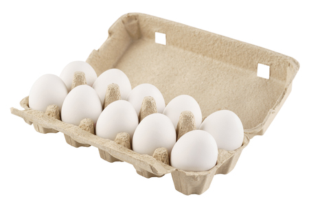 Cardboard egg box with ten eggs isolated on white. Archivio Fotografico