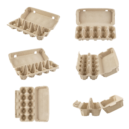 Set of empty egg cartons shot from different angles. Recyclable cardboard boxes or containers for packaging. Isolated on white.