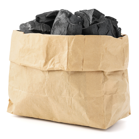 Paper bag of charcoal isolated on a white background.