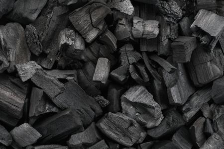 Czarny węgiel drzewny tekstura tło. Strzał z bliska. Widok z góry.