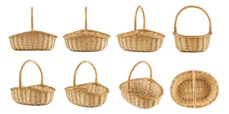 Set of wicker picnic baskets shot from different angles. Isolated on white.