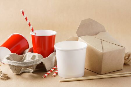 Various eco-friendly kraft paper packaging, containers for takeaway food. Zero waste and recycling concept.