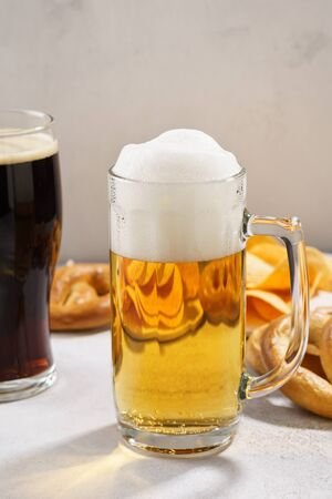 Various types of freshly poured beer - light and dark and snack variety. Copy space.