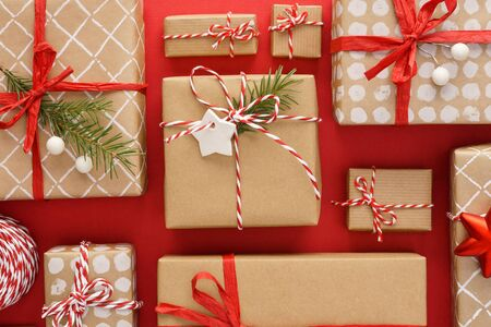 Various decorated gift boxes on red background. Flat lay.