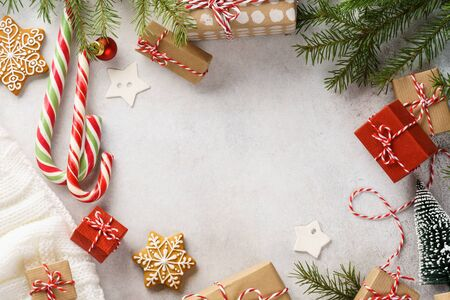 Christmas frame background with gift boxes, sweets and decoration. Xmas or New Year preparation. Flat lay with copy space.