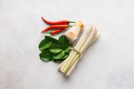 Set of Tom Yum soup main ingredients - lemon grass, chilli peppers, galanga root or galangal and kaffir lime leaves.
