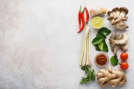 Ingredients for making Tom Yum - spicy Thai soup or other asian dishes. Oyster mushrooms, prawns, galanga root, ginger, chilli pepper, Tom Yam paste. Space for recipe.