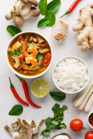 Tom Yum Goong or Tom Yam Kung and set of ingredients for cooking. Traditional Thai spicy shrimp soup with coconut milk. Top view. Reklamní fotografie