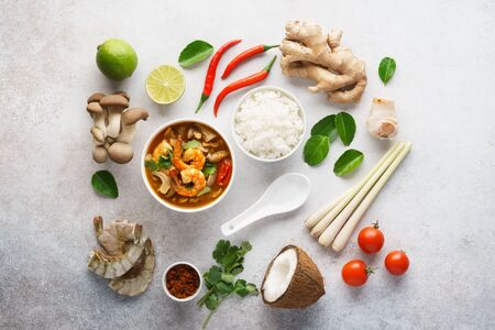 Tom Yum Goong or Tom Yam Kung and set of ingredients for cooking. Traditional Thai spicy shrimp soup with coconut milk. Flat lay.