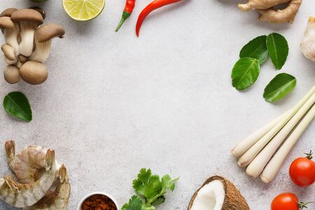 Frame made of various ingredients for making Tom Yum - traditional spicy Thai soup with mushrooms, prawns or shrimps and coconut milk. Background with copy space.