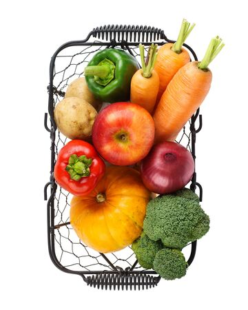 Various fresh vegetables and fruits in a wire basket. Isolated on white. Banque d'images