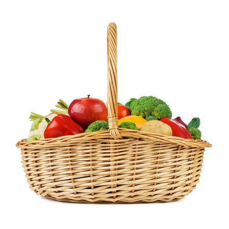 Fresh fruits and vegetables in a wicker basket. Isolated on white background.