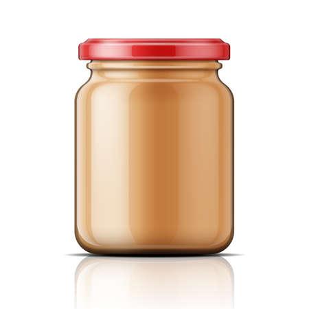 ピーナッツ バターが付いている透明なガラス瓶。