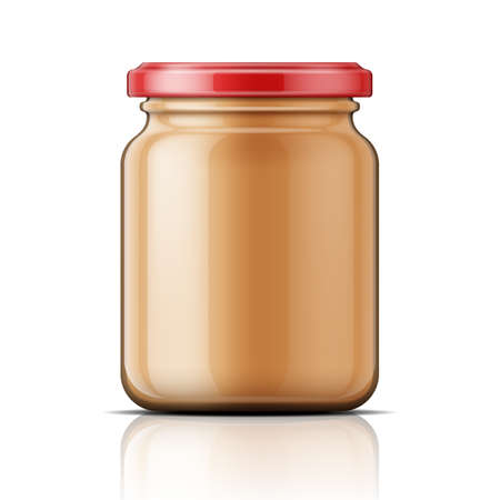 Transparent glass jar with peanut butter.