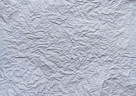 Texture of crumpled white paper with empty space.Background image.The view from the top.