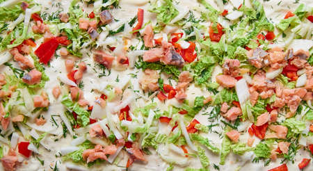 An appetizing close-up background fills the frame. Delicious ingredients top view. Bright delicious filling. Pizza. Stok Fotoğraf