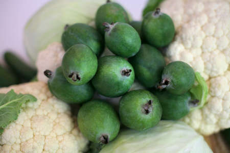 Feijoa green on a vegetable background. Feijoa Sellova fruit culture. Organic agricultural fruit, healthy food concept, plants, background, eco-friendly natural products, vegetarian, raw products
