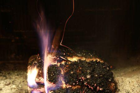 burning fire fireplace night photo
