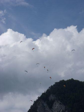 Paragliding group in the sky. 版權商用圖片