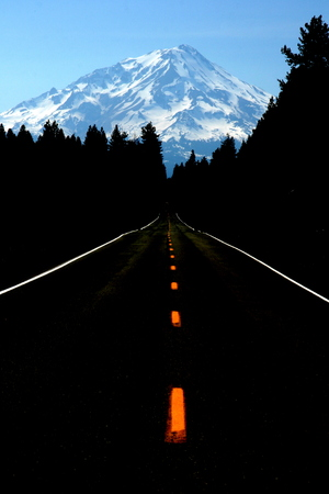 dark road towards the mountains