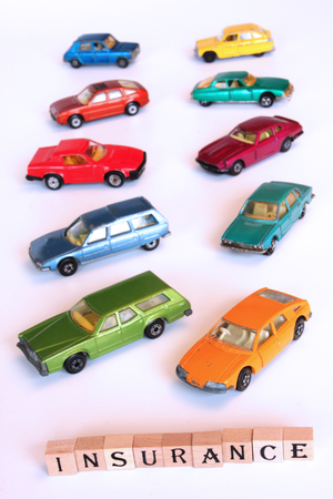 Toy cars isolated on white, concept for car insurance