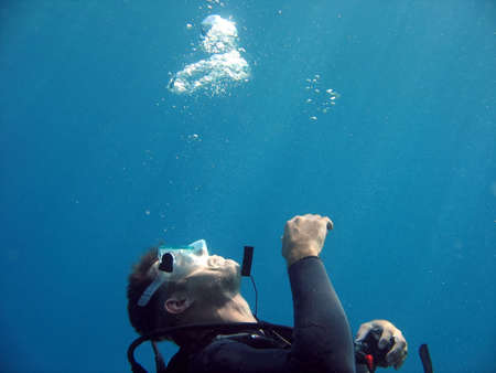 A diver blowing bubbles in the water. Stock Photo