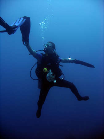 A diver doing a high five underwater.