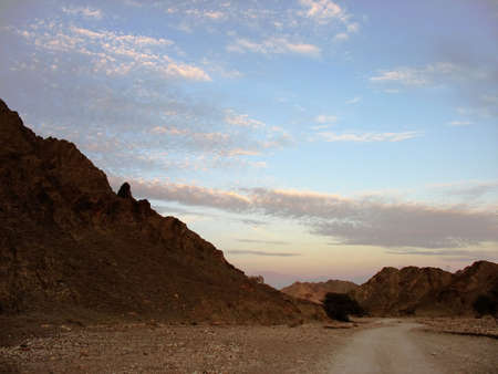 Desert road and clouds