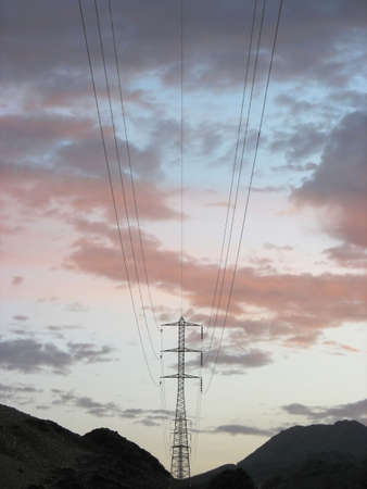 High tension power line in the desert during sunset